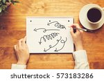 arrows with a person holding a... | Shutterstock . vector #573183286