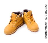 yellow boots isolated on white... | Shutterstock . vector #573187822