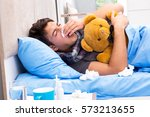 sick man with flu lying in the... | Shutterstock . vector #573213655