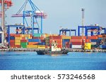 tugboat and crane in harbor... | Shutterstock . vector #573246568
