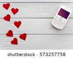 white button cell phone and red ... | Shutterstock . vector #573257758