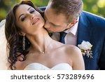 bride and groom outdoor.... | Shutterstock . vector #573289696