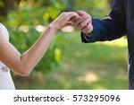 groom kiss bride s hand | Shutterstock . vector #573295096