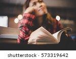 hipster woman teenager sitting... | Shutterstock . vector #573319642