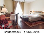 elegant hotel room with rose... | Shutterstock . vector #573333046