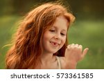 red haired little girl is... | Shutterstock . vector #573361585