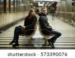 Couple Cuddling On A Bench In...