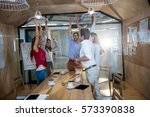 casual colleagues with hands up | Shutterstock . vector #573390838