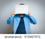 handsome man hiding behind a...   Shutterstock . vector #573407572