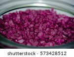 violet pebbles in a jar close up | Shutterstock . vector #573428512