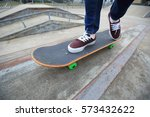 young skateboarder legs riding... | Shutterstock . vector #573432622