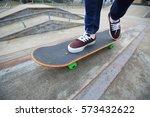 young skateboarder legs riding...   Shutterstock . vector #573432622