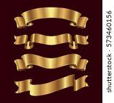 set of golden ribbons on black... | Shutterstock .eps vector #573460156