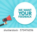 hand hold megaphone. we want... | Shutterstock .eps vector #573476356