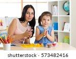 teacher and child girl learn... | Shutterstock . vector #573482416