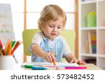 little boy paints in his... | Shutterstock . vector #573482452