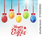color easter eggs on shiny... | Shutterstock .eps vector #573503002