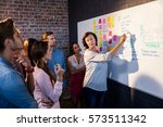 group of coworkers analyzing a... | Shutterstock . vector #573511342