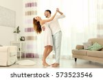 cute young couple dancing at... | Shutterstock . vector #573523546
