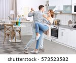 cute young couple dancing at... | Shutterstock . vector #573523582