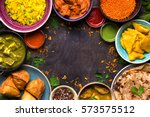 assorted indian food on dark... | Shutterstock . vector #573575512