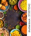 assorted indian food on dark... | Shutterstock . vector #573575542