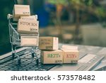 Small photo of Cartons of financial products and a shopping cart i.e commodities, bonds, stocks, mutual funds, REITs, ETFs. Ideas about portfolio selection that can be managed for optimal return online via internet.