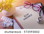 Small photo of Stethoscope on note book with acne vulgaris words as medical concept