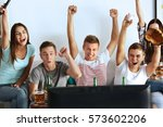 young fans watching baseball... | Shutterstock . vector #573602206