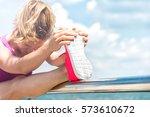 young woman running | Shutterstock . vector #573610672