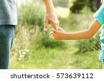 hands of parent and child in... | Shutterstock . vector #573639112