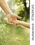 hands of parent and child in... | Shutterstock . vector #573639142