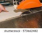 men at work sawing wood....   Shutterstock . vector #573662482