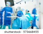 surgeon team working together... | Shutterstock . vector #573668455