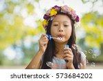 Girl Wearing Flower Wreath...