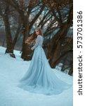 lady in a luxury lush blue... | Shutterstock . vector #573701386