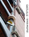 Crane hook in front of old red bricked warehouse in traditional Hamburg Speicherstadt (harbor district) - stock photo