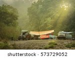 camping site at deep forest.... | Shutterstock . vector #573729052