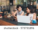 asian woman working with laptop ... | Shutterstock . vector #573731896
