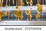 gold leaves hanging on golden...   Shutterstock . vector #573734596