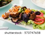 mixed mushroom salad with hot... | Shutterstock . vector #573747658