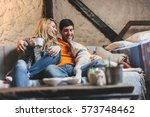 loving couple relaxing at home... | Shutterstock . vector #573748462