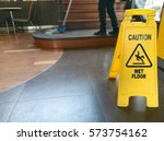 low section of worker mopping... | Shutterstock . vector #573754162