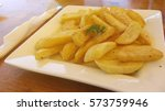 fried potatoes served in a... | Shutterstock . vector #573759946
