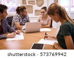 young lady checking her memo... | Shutterstock . vector #573769942
