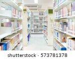 Blurred Bookshelf In Library...