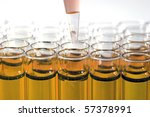 Science and Medical Research Test Tubes, being filled with pipette's and other filling devices - stock photo