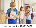 school friends bullying a sad...   Shutterstock . vector #573798472