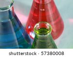 scientific and medical research beakers filled with various experiments with various colors and textures - stock photo
