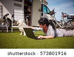 woman on the grass with a dog... | Shutterstock . vector #573801916